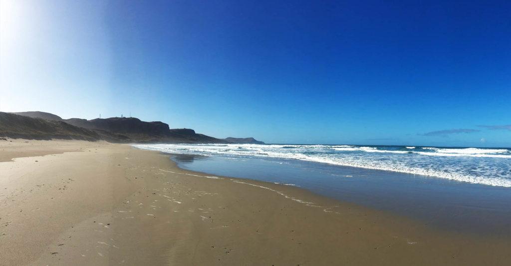 Golden sands on a beach on Islay on a sunny day